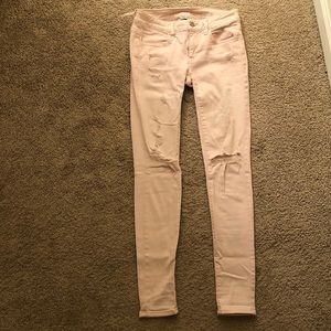 Pale pink distressed jeans